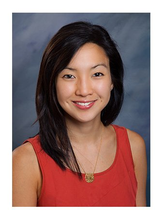 Grace Woo smiling for a headshot photo.
