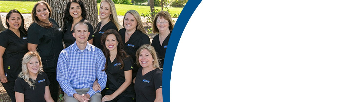 Dr. Christian Hoybjerg smiling for a group photo with the staff at Hoybjerg Family Orthodontics.